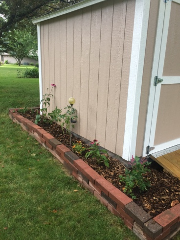 Mulch, plants, and flowers added.