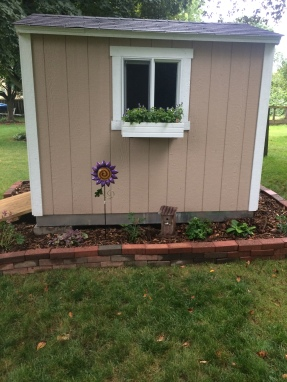I painted the window box and hung it.